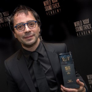 Michel holding World Soundtrack award